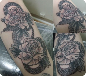 Casie Snake Flower Arm Tattoo