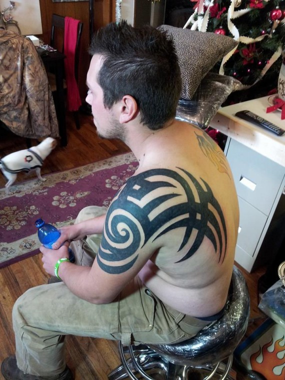 tribal arm tattoo