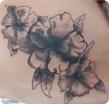 hawaiian flowers tattoo
