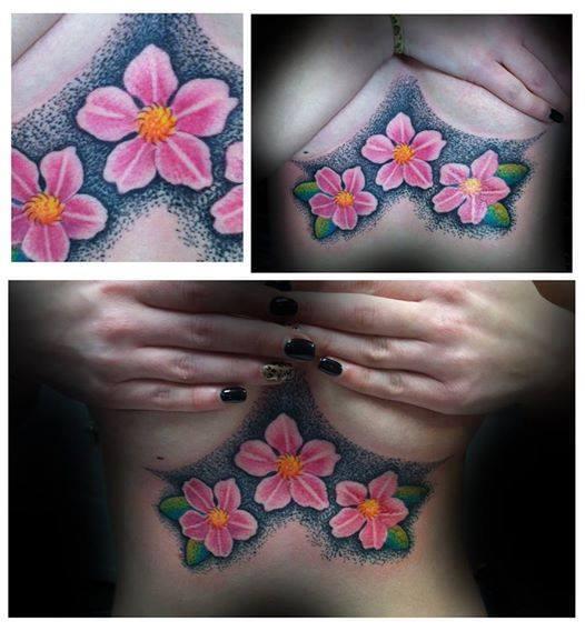 breast flower tattoo